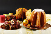 Christmas sweets on decorated table on complex background — Stok fotoğraf