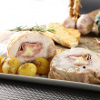 Stockfoto: Roulade of stuffed chicken with potatoes and rosemary