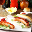Stock Photo: Hot Dog with sausage, ketchup and lettuce