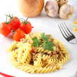 fusilli pasta with meat sauce — Stock Photo