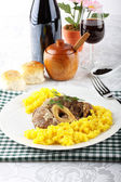 Marrowbone with saffron rice — Stock Photo