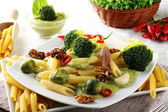 Pasta with broccoli cream and nuts — Stock Photo
