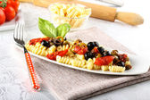 Pasta with olives, capers and tomatoes — Stock Photo