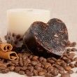 Aroma handmade soap and candle with cinnamon sticks and coffee b — Stock Photo #13370300