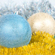 Christmas background with a blue and gold balls — Stock Photo