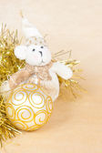 Christmas background with a ball and a bear — Stok fotoğraf