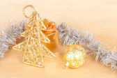 Christmas background with a ball and a tinsel — Stock Photo