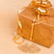 Two handmade hearts and gift box on gold — Stock Photo