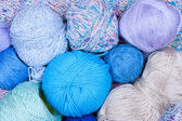Multicolored bright balls of yarn closeup — Stock Photo