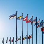 International Flags against blue sky — Stock Photo #20014273