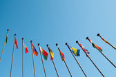 International Flags against blue sky — Stock Photo