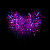 Colorful heart fireworks on the black sky — Stock Photo