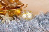 Christmas background with a gift box and a tinsel — Stock Photo