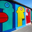 Berlin, Germany - August 01 2012: Graffiti at East Side Gallery, Berlin wall memorial — Stock Photo #12811650