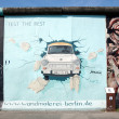 Berlin, Germany - August 01 2012: Graffiti at East Side Gallery, Berlin wall memorial — Stock Photo #13588867