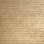 Ancient greek writing on stone — Stock Photo