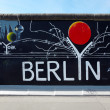 Berlin, Germany - August 01 2012: Graffiti at East Side Gallery, Berlin wall memorial — Stock Photo