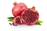 Pomegranate and half with leaves — Stock Photo