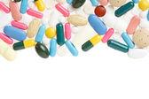Pilulka a barevné lékařské kapsle rámu, hranice — Stock fotografie