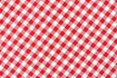 Red and white tablecloth background — Stock Photo