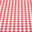 Red and white tablecloth background in perspective — Stock Photo