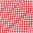 Red and white wavy gingham tablecloth texture background — Stock Photo