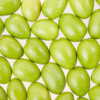 Green olives texture background — Stok Fotoğraf #33584243