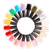 Nail polish colorful bottles circle — Stock Photo