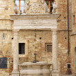 Well in the main Square of Montepulciano - Italy - Stock Photo