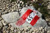 Mountain sign painted on a rock - Dolomites — Stock Photo