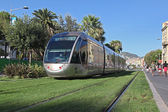 NICE FRANCE - AUGUST 25: Modern tram in the center of Nice France on August 25 2013. Central Square -For a long stretch of the tram tracks emerge from grass. — Stock Photo