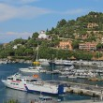 Постер, плакат: Boats in the small harbor of Porto Santo Stefano the pearl of the Mediterranean Sea Tuscany Italy
