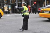Police woman directing traffic in Manhattan — Stock Photo