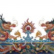 Stock Photo: Glance of Dragon on Thai temple roof isolate white backgroun
