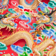 Chinese dragon statue on temple wall in Thailand — Stock Photo