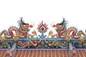 Glance of the Dragon on Thai temple roof — Stock Photo