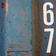 Numeric on grunge blue steel texture — Stock Photo