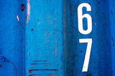 Numeric on grunge blue steel texured as background — Stock Photo