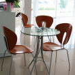 Chairs and table set in showroom — Stock Photo