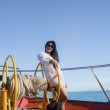 Asian girl sailing on a yacht — Stock Photo #13862578
