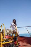 Asian girl sailing on a yacht — Stock Photo