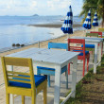 Outdoor beach restaurant at tropical resort. — Stock Photo #22037615
