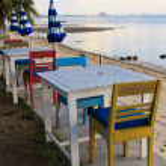 Outdoor beach restaurant at tropical resort. — Stock Photo #22037857