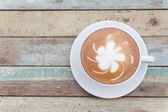 Hot coffee lattee on grunge background — Stock Photo