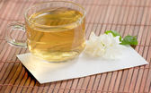 Cup of jasmine tea and flower — Foto de Stock