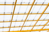 Roof and yellow cradle — Stock Photo