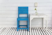 White table and blue wooden chair — Stock Photo