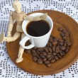Wooden doll and espresso shot on crochet background — Stock Photo