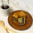 coffe cup and moon cake serve on wooden dish — Stock Photo