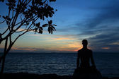 Silhouette of yoga male in lotus pose — Stock Photo